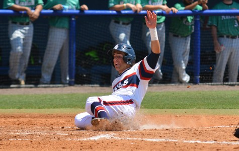 Junior second baseman Bret Lashley scores in Sunday's noon victory over Marshall. Usually starting at first base, Lashley was moved over to second base this series due to an injury to sophomore Stephen Kerr. Michelle Friswell | Associate Editor