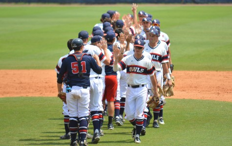 FAU players celebrate  after a win vs Old Dominion on April 26. The Owls beat ODU 6-4 during the tournament. Photo by Michelle Friswell | Associate Editor