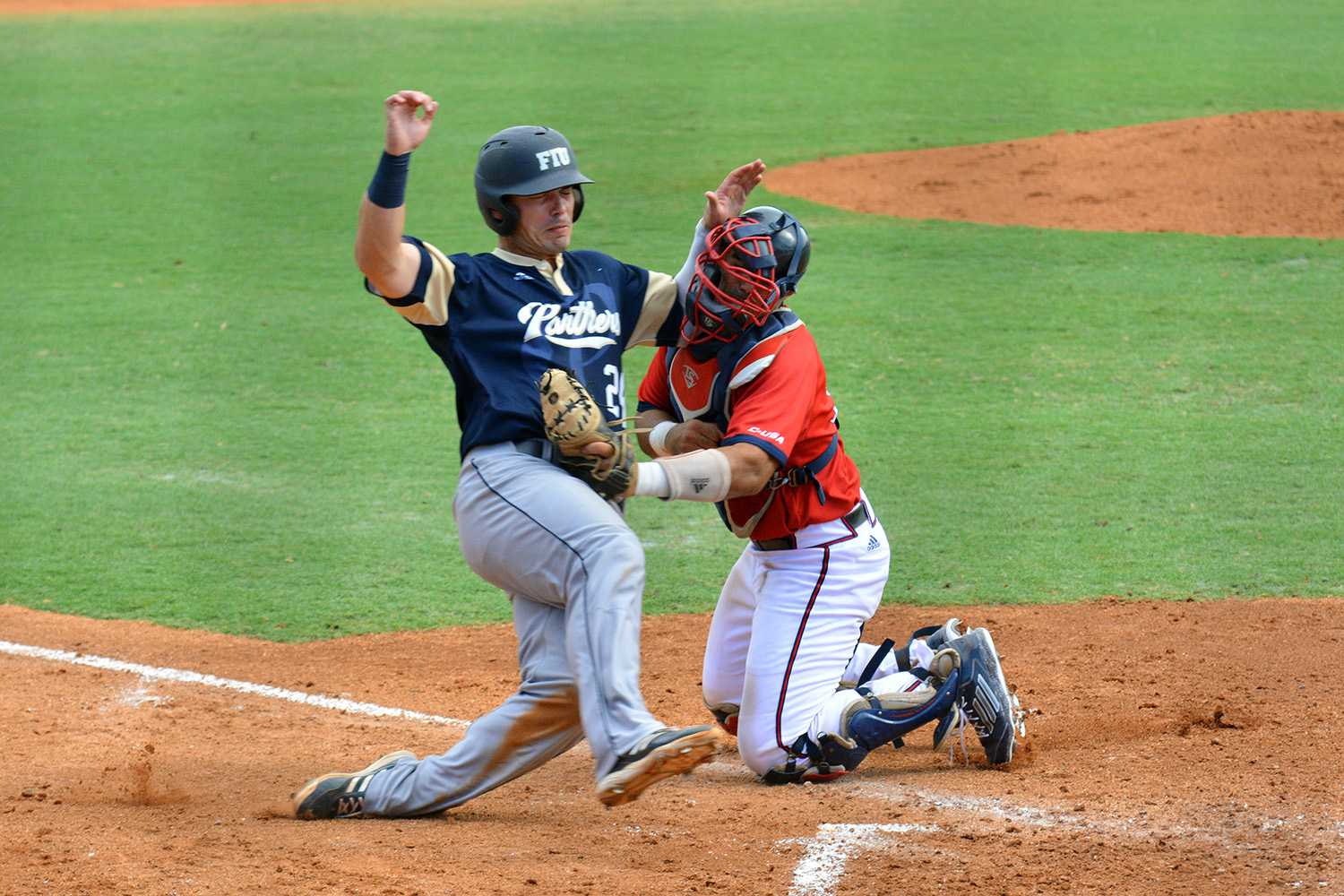 FIU attempts to score against FAU early in Saturday's matchup. FAU came back to win the game 8-3 thanks to a powerful sixth inning for the Owls. Michelle Friswell | Associate Editor