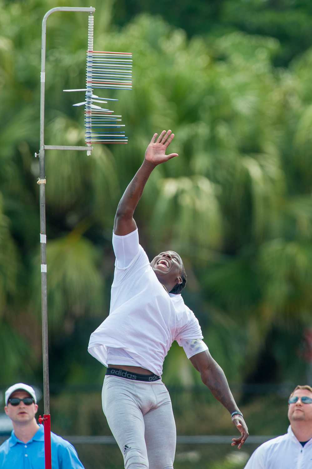 Wide Receiver Lucky Whitehead jumps and reaches during a vertical measurement test at FAU's pro day. Max Jackson | Photo Editor