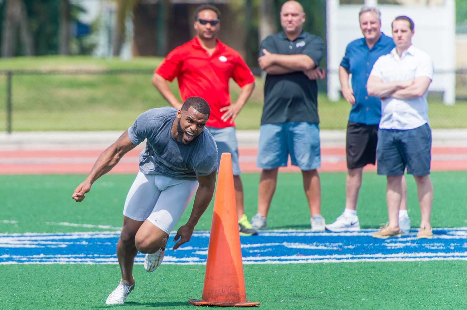Wide Receiver Daniel McKinney runs through the three cone drill as onlookers take his time. Max Jackson | Photo Editor