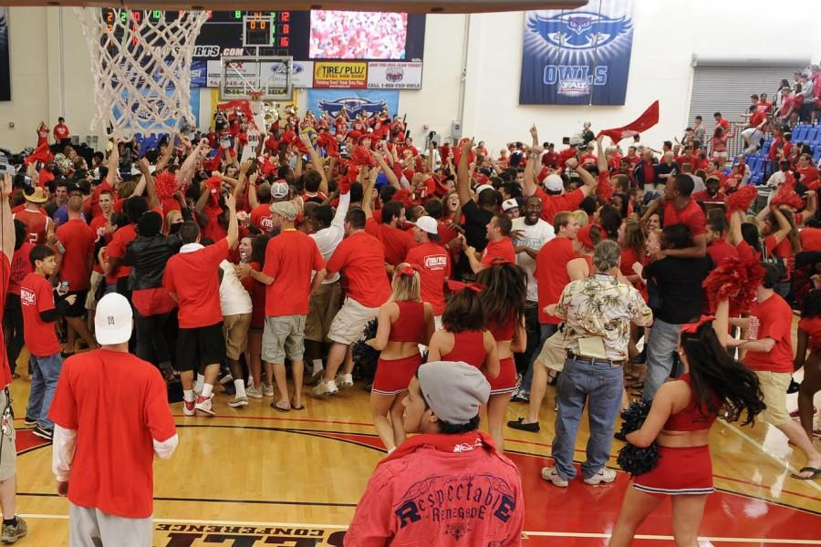 Students+rush+the+floor+in+celebration+after+senior+forward+Brett+Royster+made+the+winning+basket+against+FIU+2011.+Photo+courtesy+of+Owlpix.com