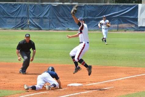 First baseman Esteban Puerta jumps while attempting to catch a throw during the third game of the series. FAU lost the game 5-2. Photo by Michelle Friswell