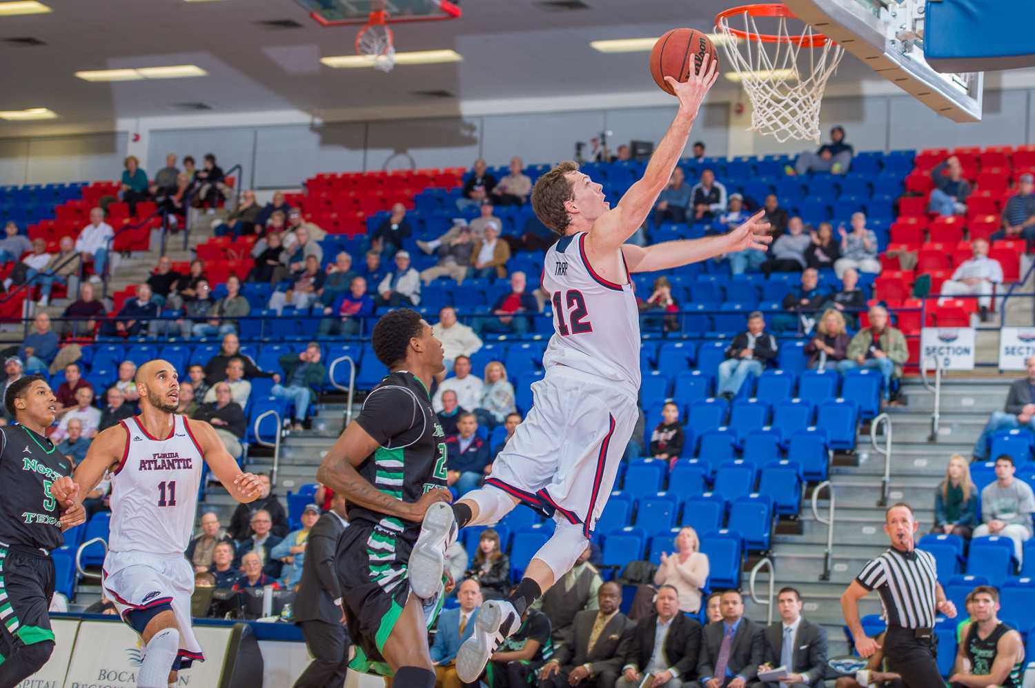 Possessions in men's college basketball will be 30 seconds next season, meaning more chances to score for Jackson Trapp (12) and the FAU basketball program. Photo by Max Jackson
