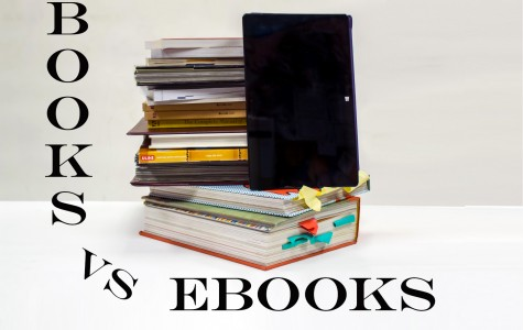 Posed books and tablet. Emily Creighton | Features Editor