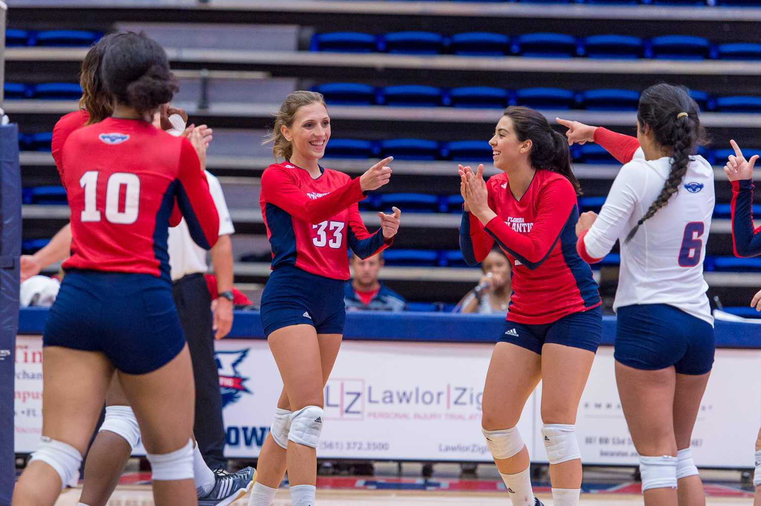 The Owl's celebrate after a successful volley against Stetson on during the FAU Invitational Tournament. FAU continued its success at UNF's Mayo Invitational, winning two games. Max Jackson | Staff Photographer