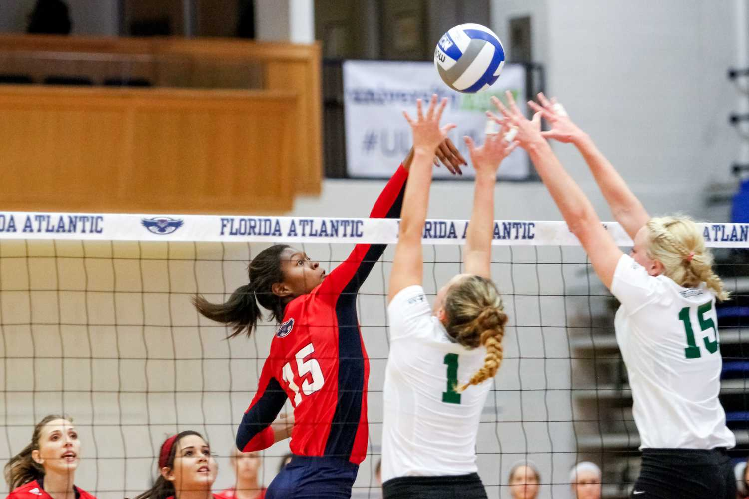 Opposite hitter Gabrielle Dixon blocks a Stetson scoring attempt on Friday during the FAU Invitational tournament. Mohammed F Emran | Staff Photographer