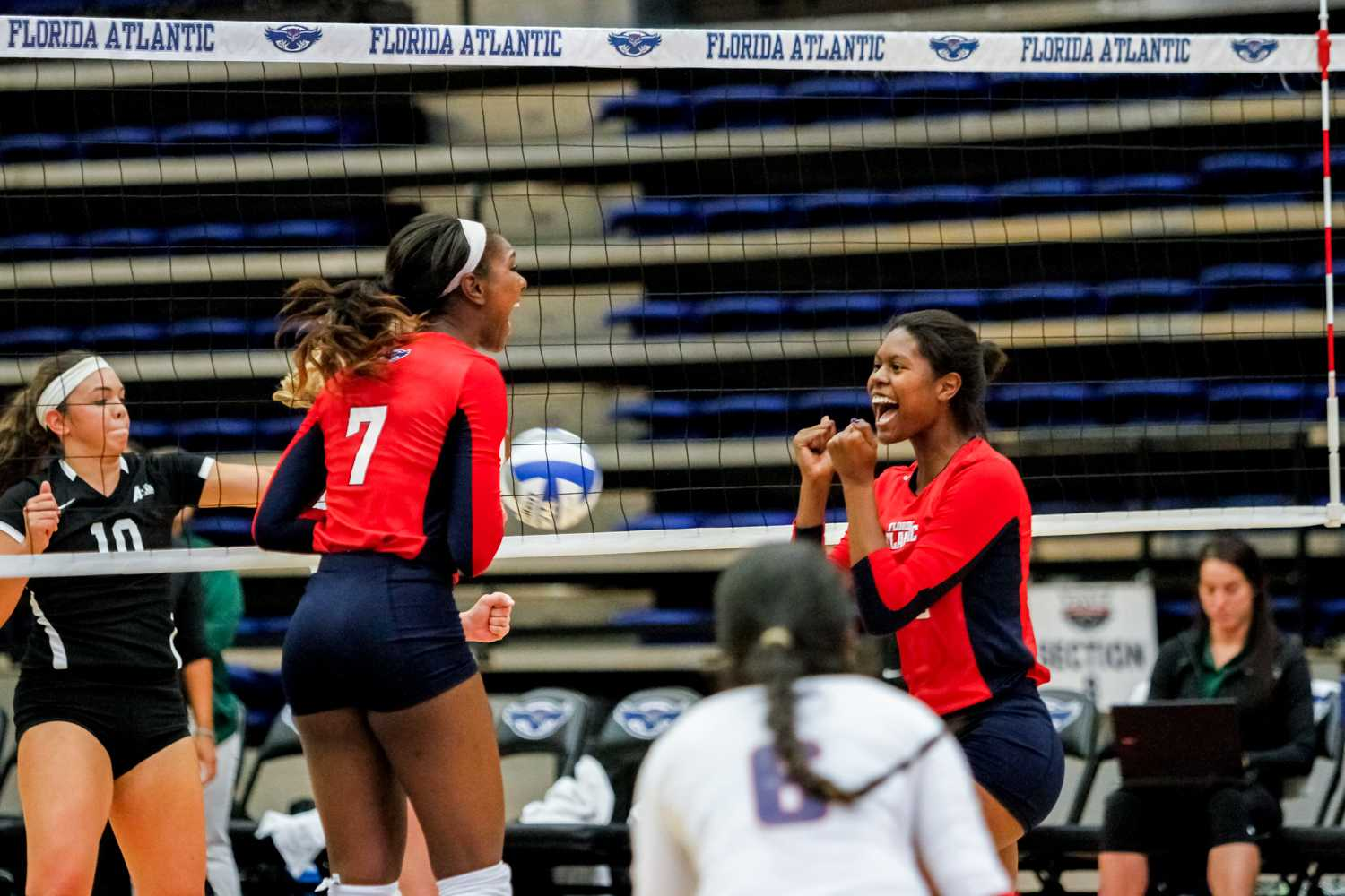 Middle blocker Brittney Brown (left) and opposite hitter Gabrielle Dixon (right) celebrate after earning a point for the Owls. Mohammed F Emran | Staff Photographer