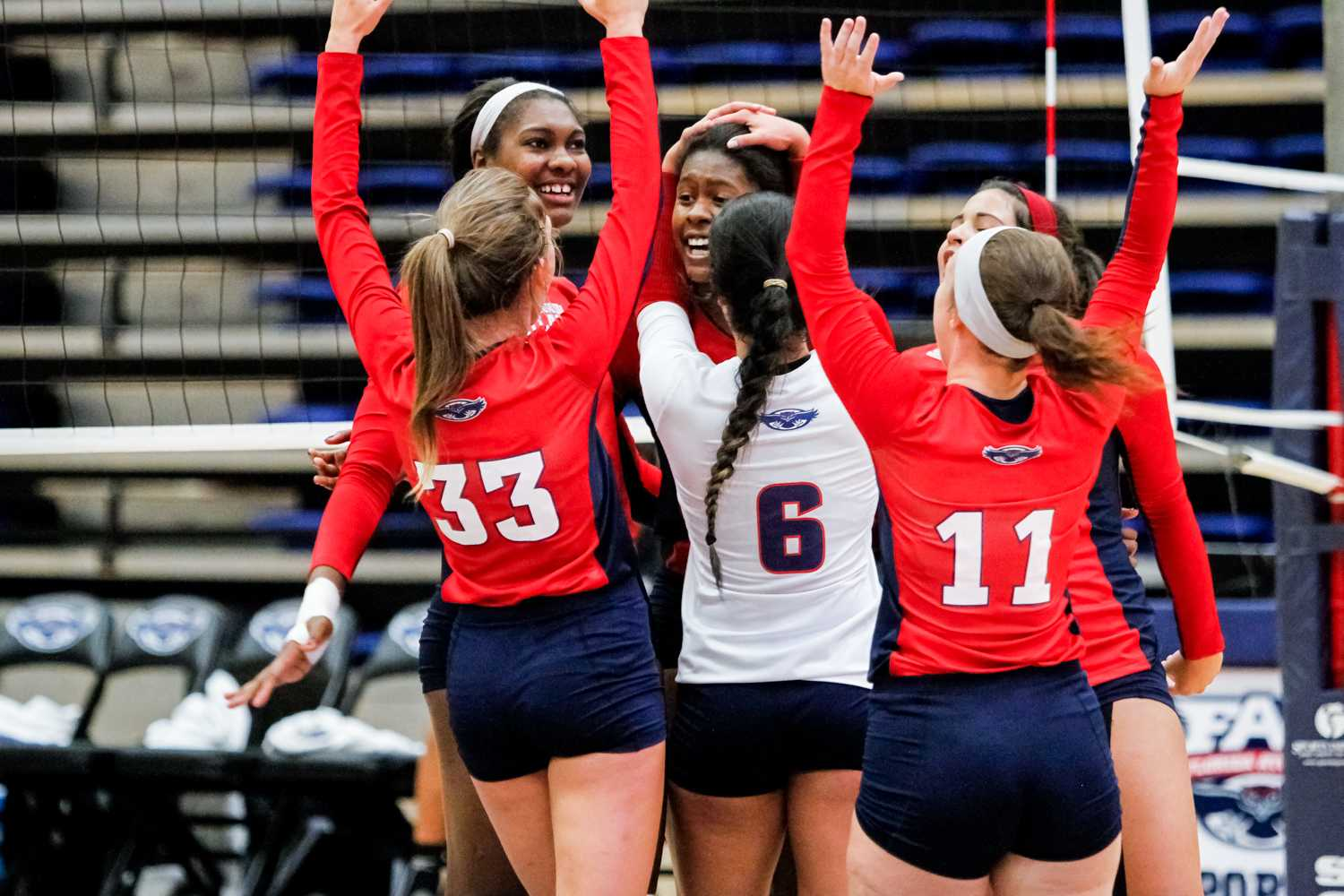 The Owls celebrate after earning the final point to sweep the Stetson Hatters in the second game of the FAU Invitational tournament. Mohammed F Emran | Staff Photographer