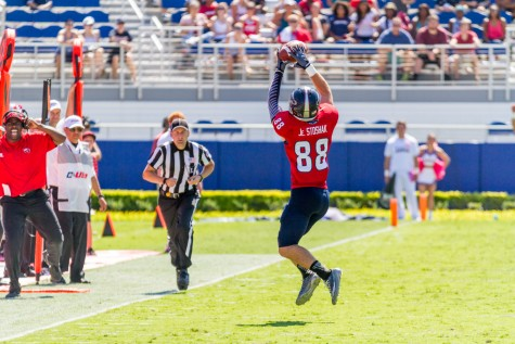 Wide receiver Jenson Stoshak makes a catch during last season's game versus Western Kentucky. Photo by Mohammed Emran