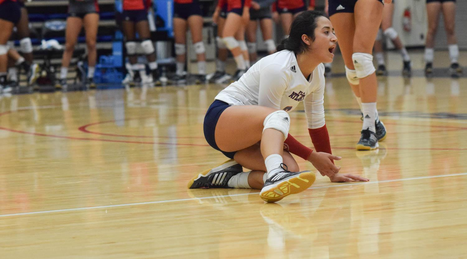 Nathalie Rosado gets back up after attempting to save a volley during the second set of the Owls match versus GSU on Saturday night. Ryan Lynch | Sports Editor