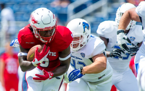 Greg (Buddy) Howell (9), a sophomore running back for the Owls, starts FAU's opening drive Saturday with a 13 yard rush to the 38 yard line.  Howell rushed for 78 yards with an average of 5.4 yards per carry. Max Jackson | Staff Phtotgrapher