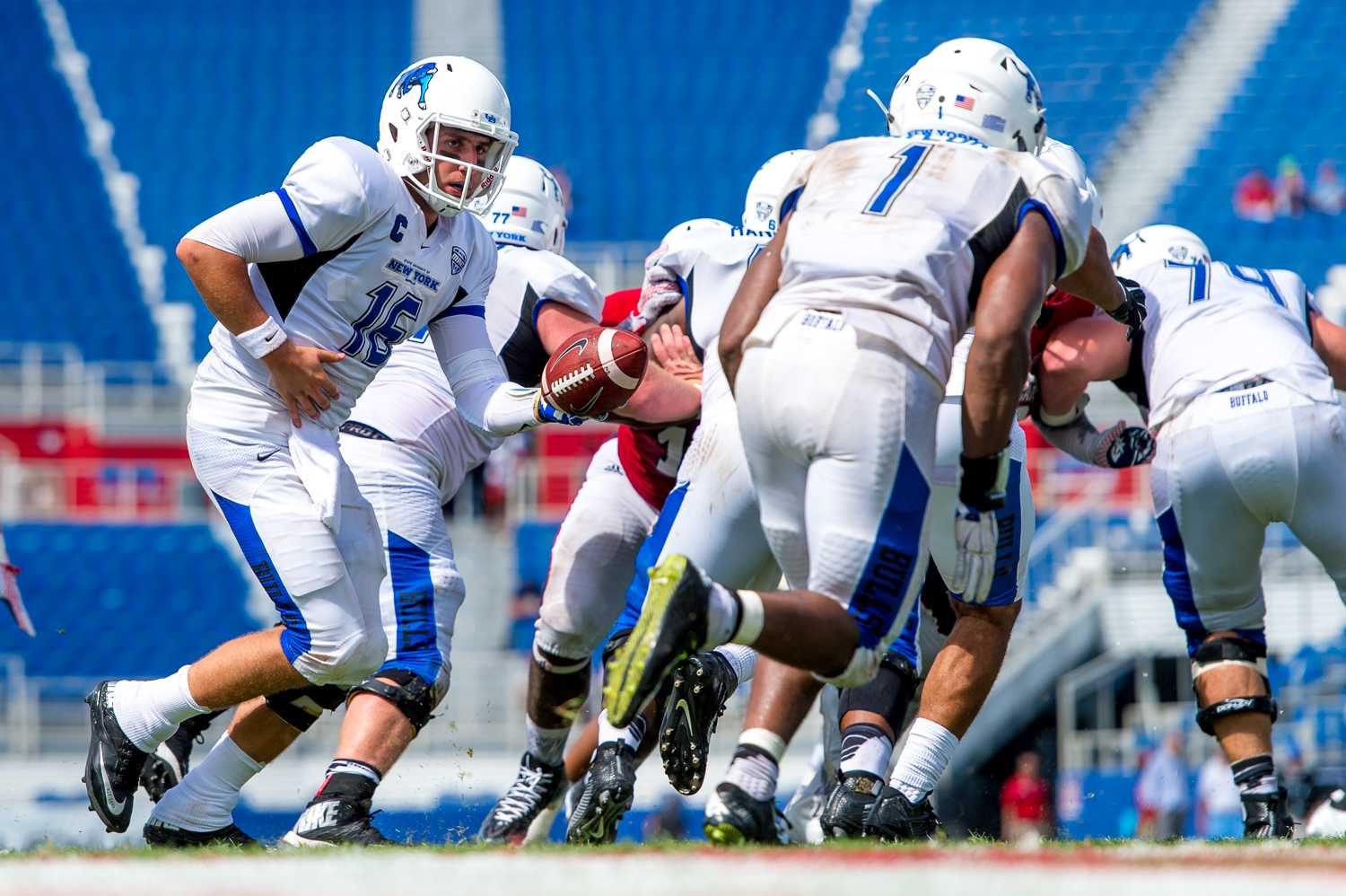 Buffalo Bulls quarterback Joe Licata (16) hands off the ball to Anthone Taylor (1) in one of the Bulls' final plays of the game Saturday. Max Jackson | Staff Photographer