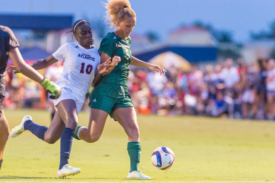 Junior forward for FAU Geovana Alves (10) attempts to get around Miami defender Maisie Baker (5) to gain possession of the ball. Alves scored once during the three games this week. Max Jackson|Staff Photographer