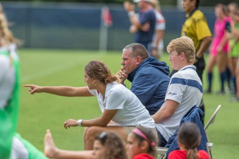 FAU Assistant Coach Jordan Reppell talks with Head Coach Patrick Baker during the second half of Sunday's game against UTSA. Brandon Harrington|Photo Editor