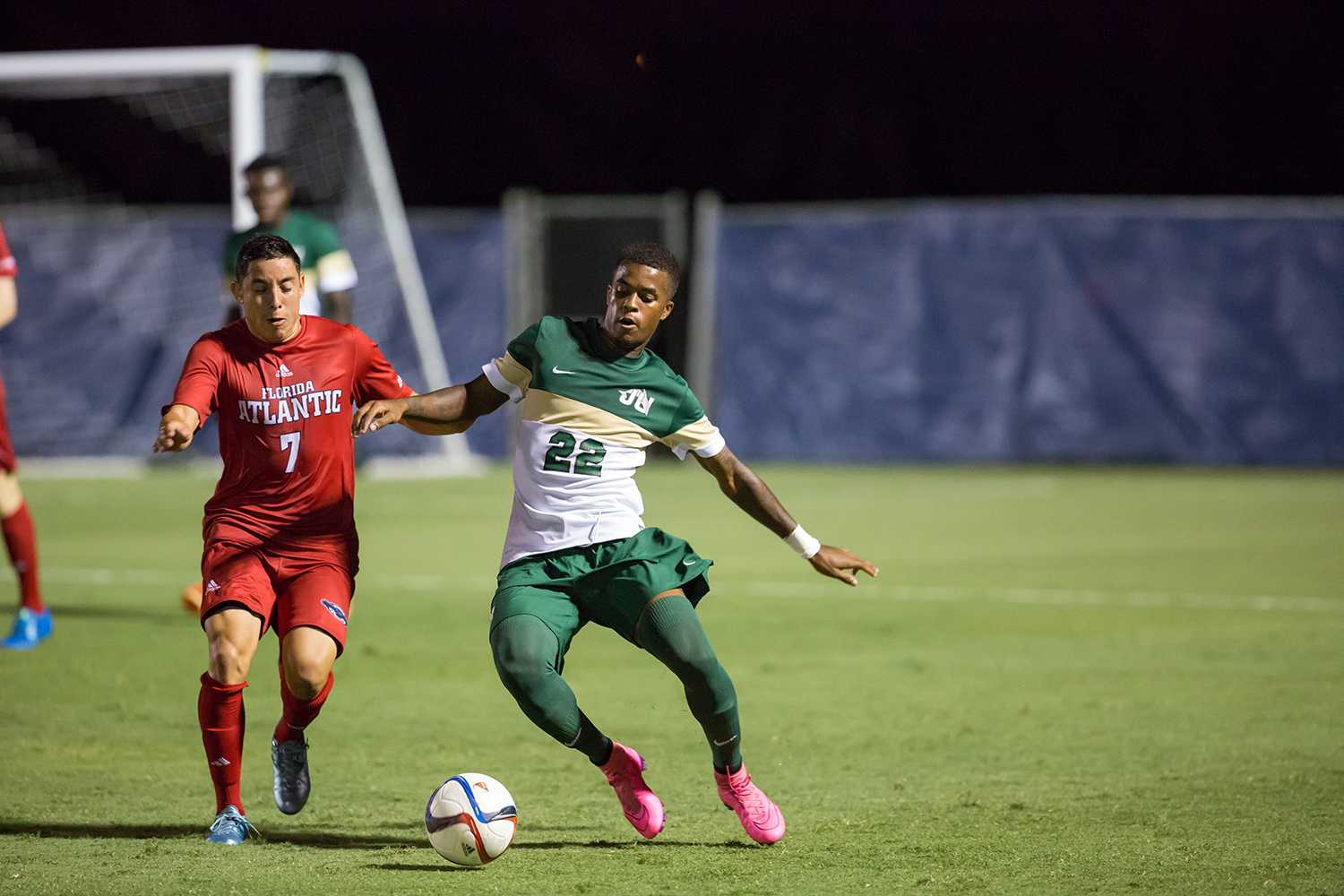 Senior midfielder Ronald Garcia (7) fights for possession against junior defender Joe Amico (22) in the Owls' first home game of the season against the Jacksonville Dolphins. Brandon Harrington | Contributing Photographer