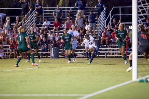FAU junior forward Sammy Rowland (22) makes a goal attempt against Hurricane goalie Phallon Tullis-Joyce (91) early in the second half of Friday night's game. Photo by Brandon Harrington|Contributing Photographer