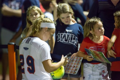 FAU junior defender Kelsey Parry (29) signs autographs for Owls fans after a 3-1 win against the University of Miami. Photo by Brandon Harrington| Contributing Photographer