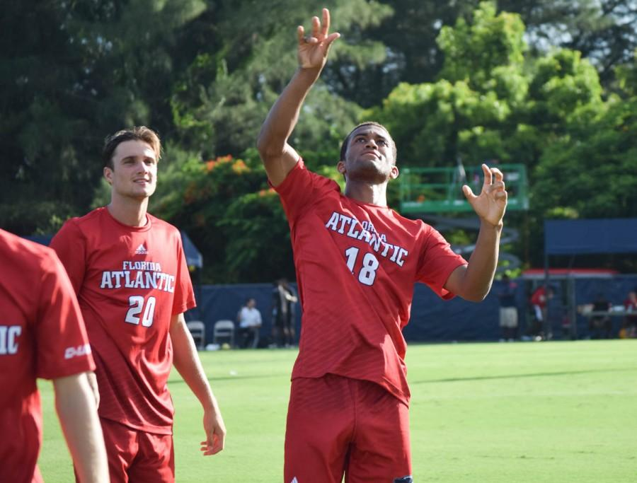 Junior+defender+David+Adejunmobi+%2818%29+tosses+a+hackey+sack+into+the+crowd+before+Sept.+3+game+versus+the+Jacksonville+University+Dolphins.+Ryan+Lynch+%7C+Sports+Editor%0A