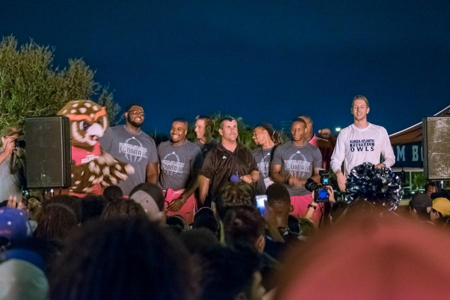 Coach Charlie Partridge speaks at the bonfire rally with the football team. Mohammed F Emran | Staff Photographer