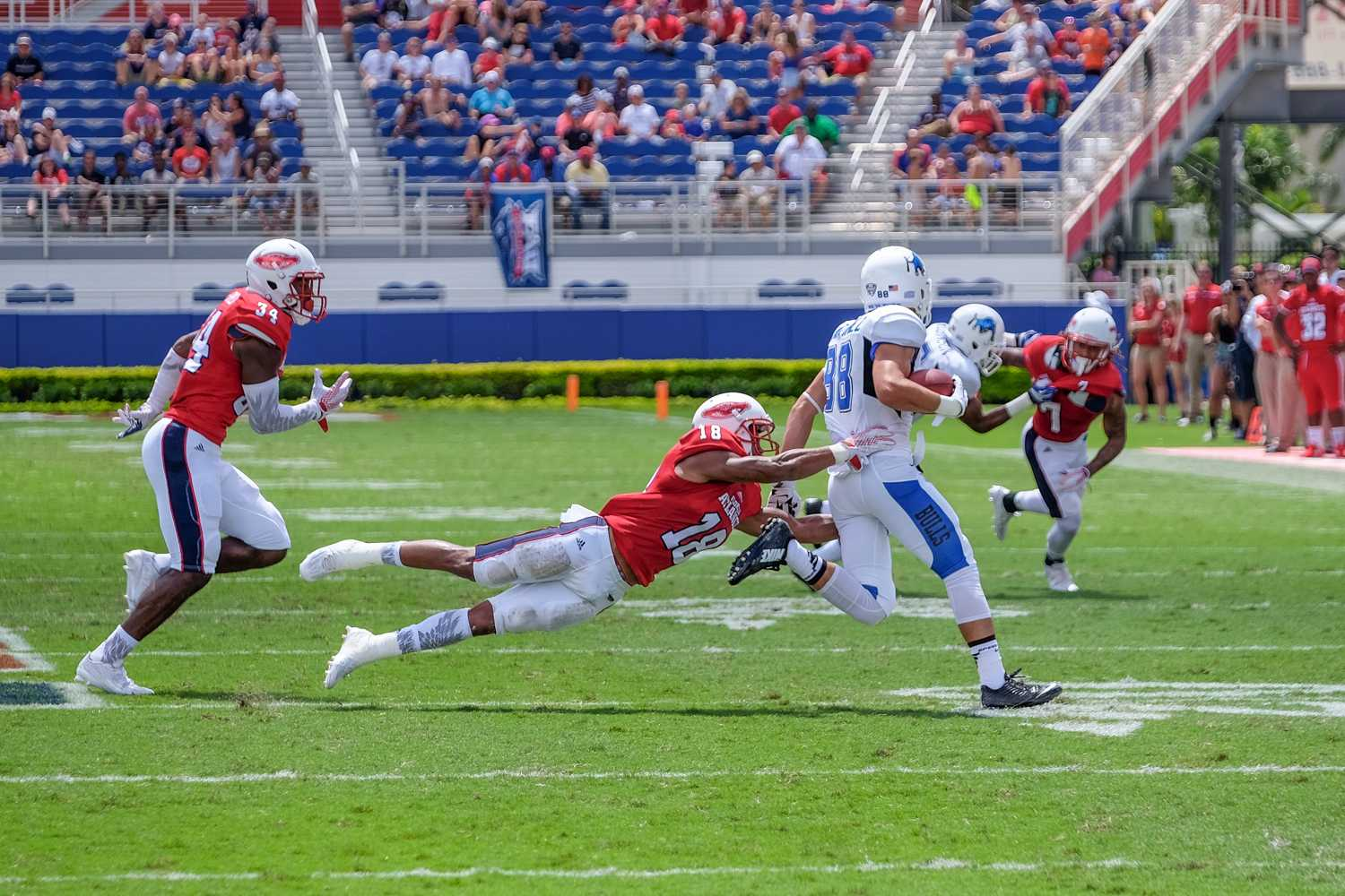 Freshman safety Jalen Young (18) tackles Buffalo wide receiver Jacob Martinez (88). Mohammed F Emran   Staff Photographer
