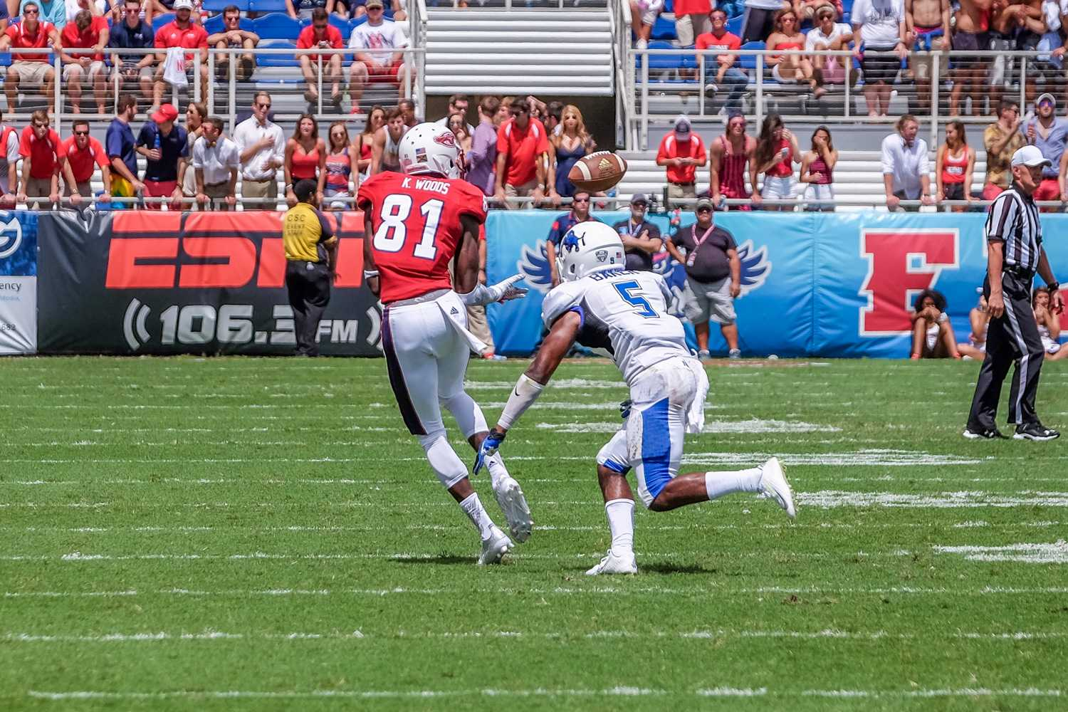 Kalib Woods (81) catches the ball in traffic as Buffalo cornerback Marquis Baker waits to tackle. Woods totaled 35 yard. Mohammed F Emran | Staff Photographer