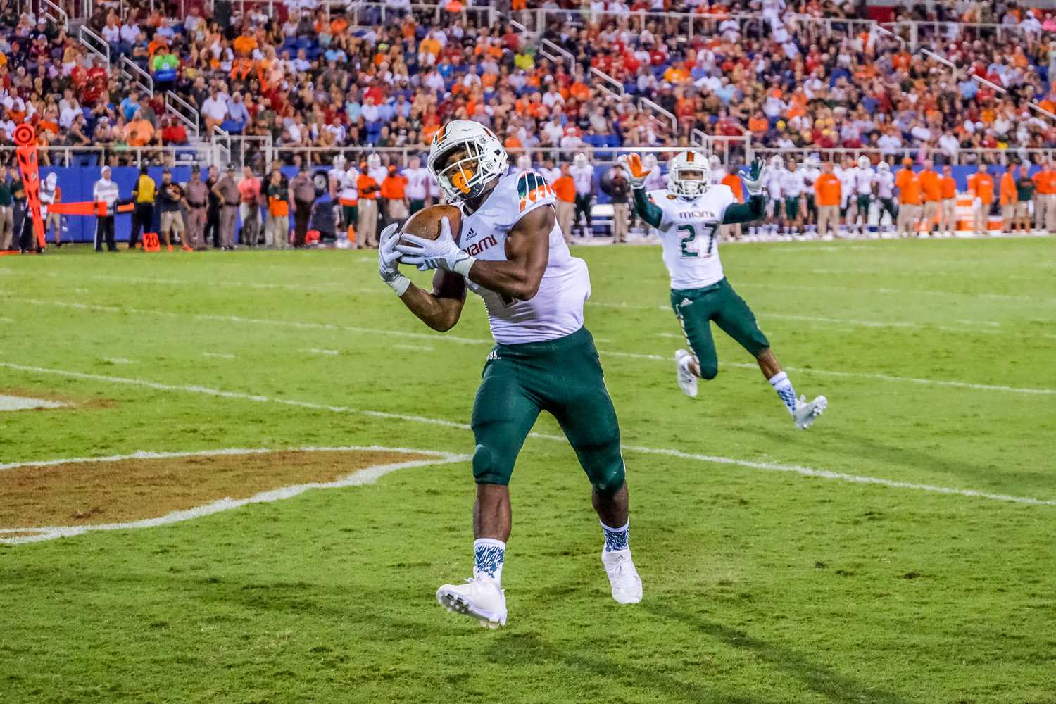 UM freshman running back Mark Walton (1), makes a four yard touchdown run during Friday's game. Mohammed F Emran | Staff Photographer