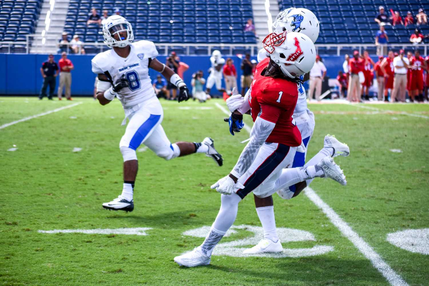 Wide receiver Henry Bussey (1) watches as an overthrown pass sails high above his head during the Owls Sept. 19 win versus Buffalo. Bussey ran for a total of 34 yards with an average of 11.3 yards per carry on the day. Alexis Hayward   Web Editor
