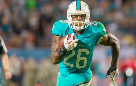 Dolphins running back Lamar Miller runs the ball versus the Buffalo Bills during last season's matchup between the two teams. Photo by Max Jackson Staff Photographer