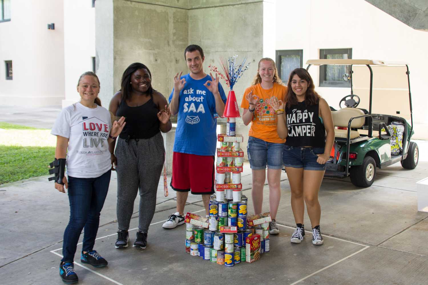 Members of the Student Alumni Association pose with their finished sculpture Tuesday. Photo by Patrick Martin|News Editor