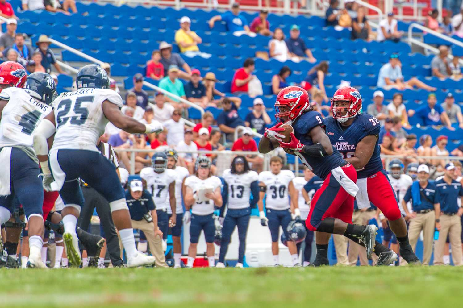 "Sophomore running back Greg ""Buddy"" Howell (9) rushes during FAU's first possession of the second half. The drive resulted in a 27-yard field goal, which gave FAU a 17-14 lead over Rice. Max Jackson 