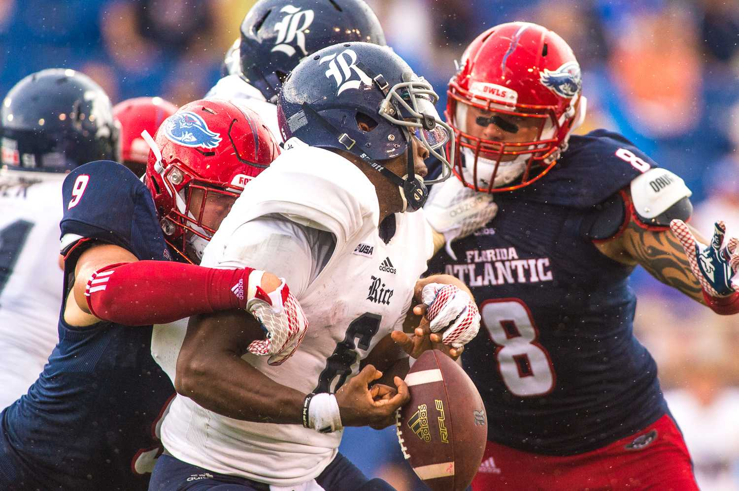 Junior defensive end for the FAU Owls, Trey Hendrickson (9), sacks Rice quarterback Driphus Jackson (6), forcing a fumble that lead to FAU gaining possession on Rice's 27-yard line. Max Jackson | Staff Photographer