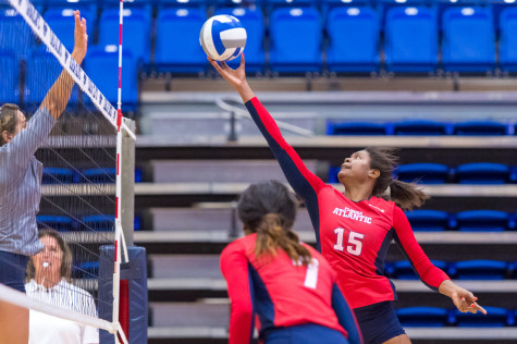 Owls redshirt freshman Gabrielle Dixon (15) reaches to tip the ball over a defender during one of the final volleys of the night. Max Jackson | Staff Photographer