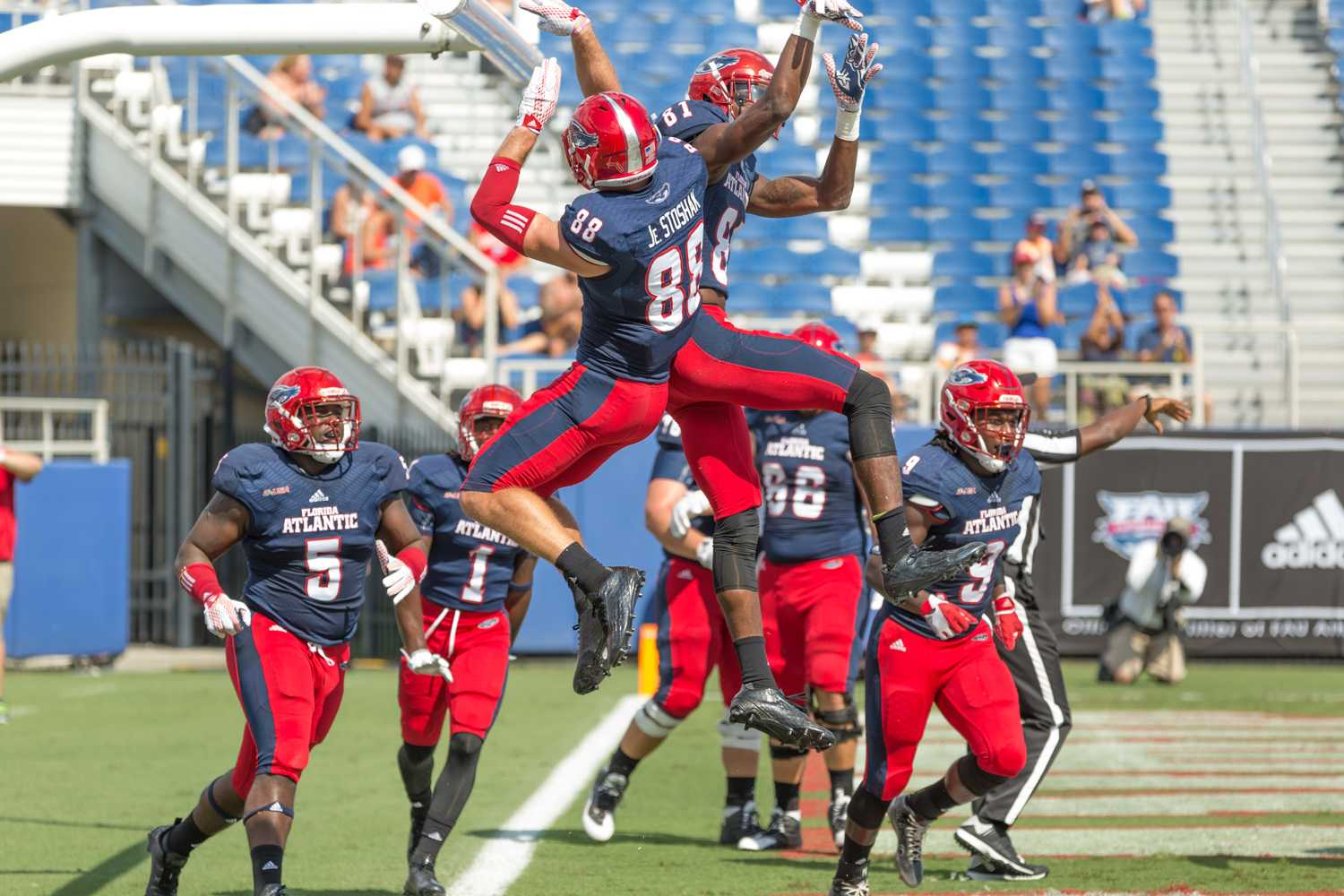 Senior wide receiver Jenson Stoshak (88) and sophomore receiver Kalib Woods (81) celebrate after FAU's first touchdown of the game against Rice on Saturday. Brandon Harrington | Photo Editor
