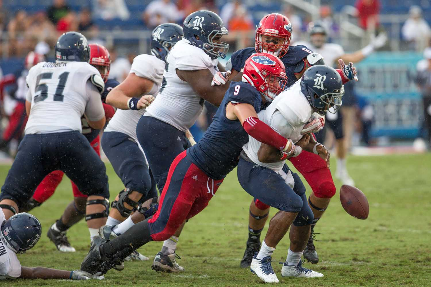 Junior defensive end Trey Hendrickson (9) sacks Rice quarterback Driphus Jackson (6). Brandon Harrington | Photo Editor