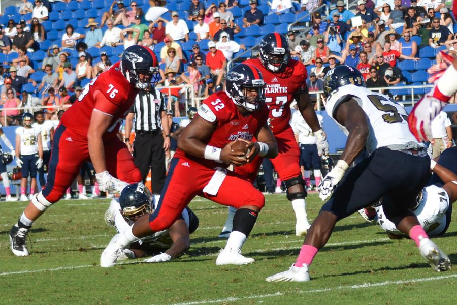 Redshirt senior quarterback Jaquez Johnson runs out of the pocket during the Owls' 31-17 win versus Florida International. Emily Creighton | Features Editor