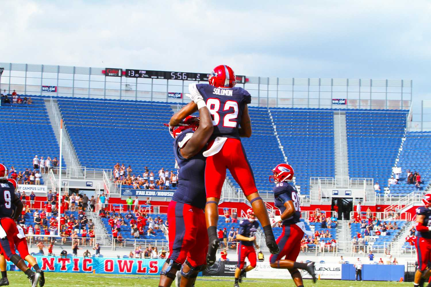 Celebration awaits Kamrin Solomon (82) after a momentous touchdown. Jessica Wilerson | Contributing Photographer