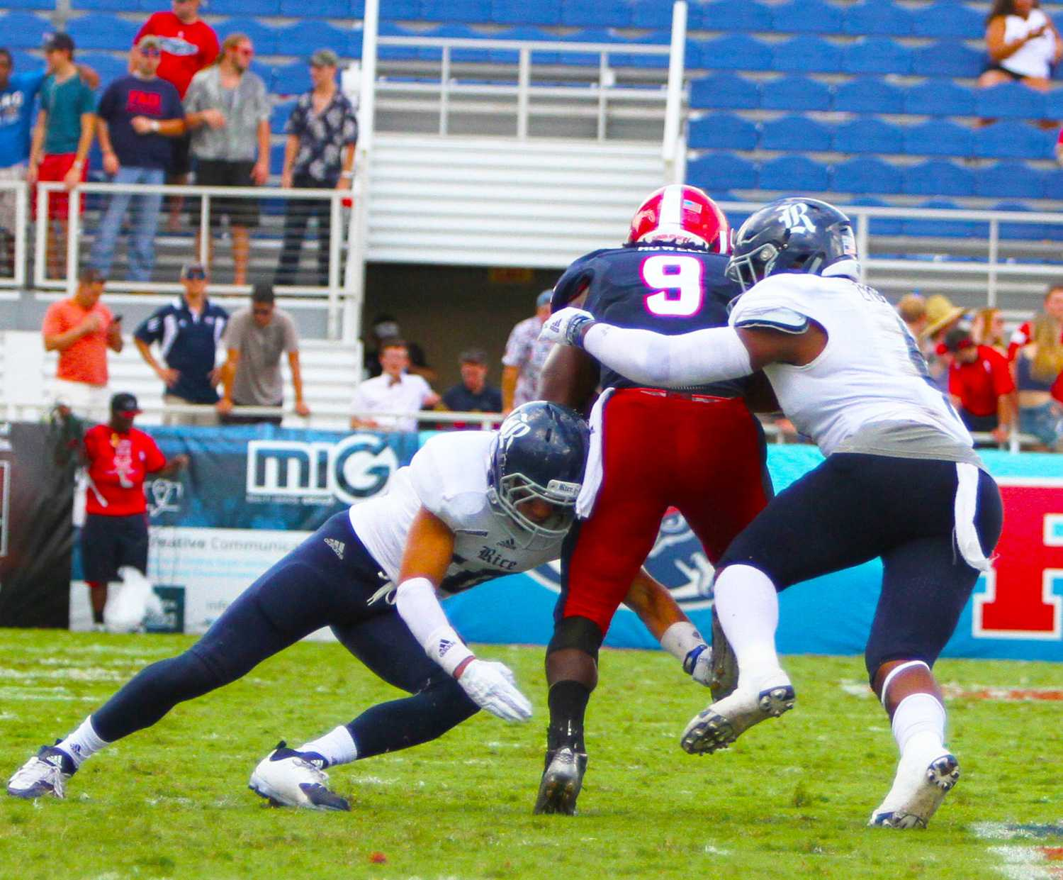 FAU sophomore running back Greg Howell (9) goes for the endzone but gets slammed in a Rice sandwich by freshman safety J.P. Thompson (10) and junior linebacker. Jessica Wilkerson | Contributing Photographer