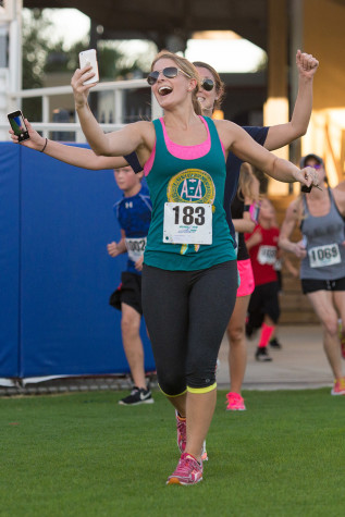 Senior business major Haley Brueggemann takes a selfie during the Homecoming Run for Autism. Photo by Max Jackson