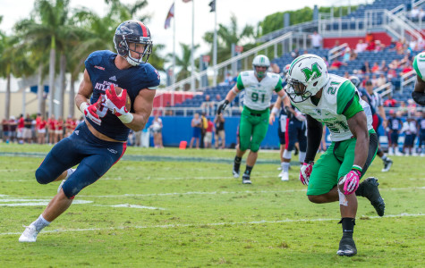 FAU tight end Tyler Cameron (3) eyes up Marshall defender Tiquan Lang (21) as he picks up five yards in the third quarter of last Saturday's 33-17 loss. Cameron had 111 receiving yards on the day – more than all other Owls receivers combined. Photo by Max Jackson|Staff Photographer