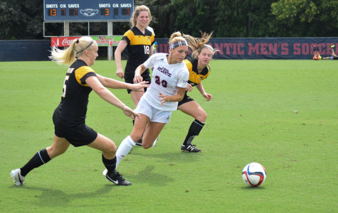 Sophomore midfielder Maddie Pung dribbles through a group of Southern Mississippi defenders during her team's 3-0 win on Sunday. Photo by Ryan Lynch|Sports Editor