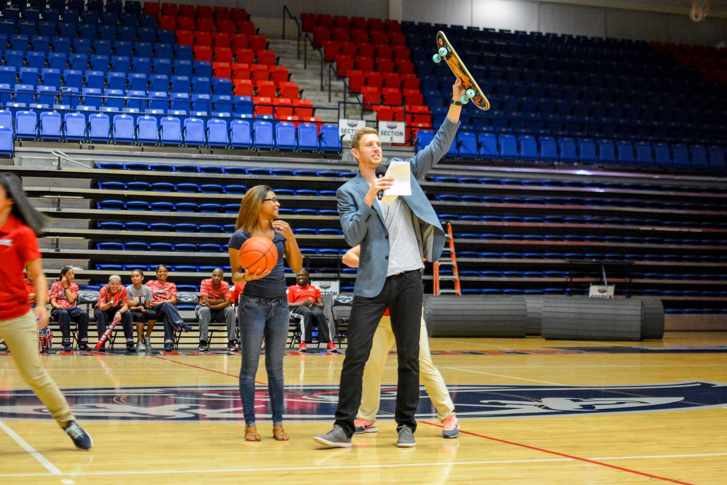 The half-court free throw contestant wins a consolation prize in form of a skateboard after missing the shot. Emily Creighton | Features Editor