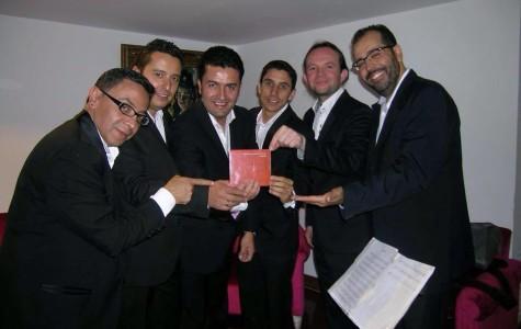 The band, Quinteto Leopoldo Federico, with their album. Photo courtesy by Hoot Wisdom
