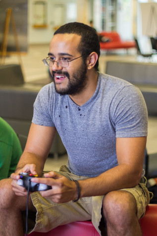Junior ocean engineering major Justin Dalton playing video games at the Student Union on the Boca Raton campus. Photo by Andrew Fraieli