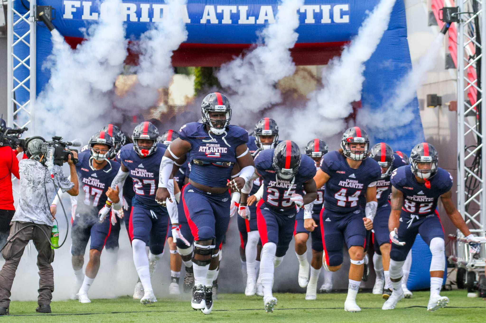 Owls players run out before Saturday's 33-17 loss versus Marshall. FAU is now 0-3 all time versus the Thundering Herd. Photo by Mohammed Emran|Asst. Creative Director