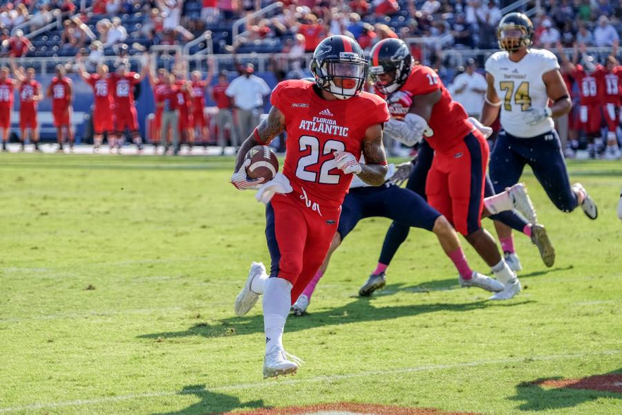 Freshman+running+back+Trey+Rodriguez+towards+the+endzone+during+the+first+half+of+Saturday%27s+31-17+Win+versus+Miami.+Rodriguez+had+94+yards+of+rushing+and+two+touchdowns+during+the+game.+Mohmmed+Emran+%7C+Asst.+Creative+Director