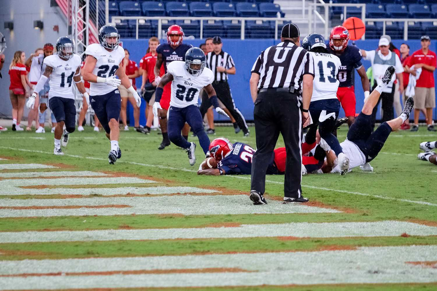 Freshman running back Trey Rodriguez (22) carries the ball into the endzone to score a nine yard touchdown, giving FAU a 26-14 with 13:50 remaining. The game was Rodriguez's first as an Owl, having been suspended for four previous games. Mohammed F Emran | Asst. Creative Director