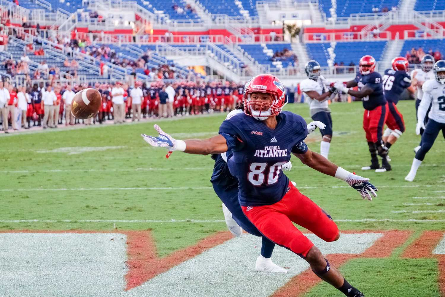 Sophomore tight end Nate Terry (80) reaches for a pass from redshirt freshman quarterback Jason Driskel (16) during a two-point conversion attempt in the fourth quarter. The failed conversion was the first play for FAU after a 90 minute long weather delay. Mohammed F Emran | Asst. Creative Director