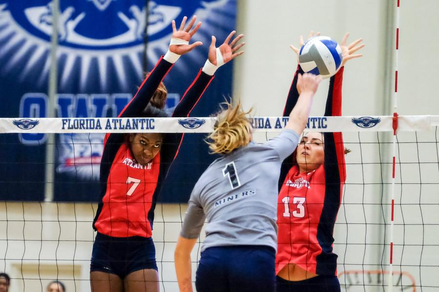 Senior middle blocker Brittney Brown and junior outside hitter Maja Ristic attempt to block UTEP outside hitter Coline Coessens during last Friday's match. Mohammed F Emran   Staff Photographer