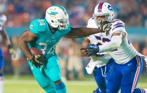 Miami Dolphins running back Damien Williams stiff arms linebacker Preston Brown during Miami's 22-9 win versus the Buffalo Bills last year. Max Jackson   Staff Photographer